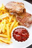 Fried steak with french fries Royalty Free Stock Photo