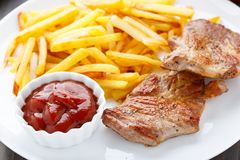 Fried steak with french fries Royalty Free Stock Photography