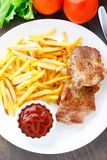 Fried steak with french fries Stock Image