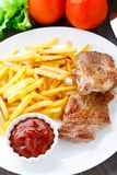 Fried steak with french fries Stock Images