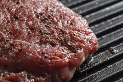Fried steak on a grill Stock Image