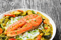 Fried steak of red fish with rice and homemade curry Stock Image