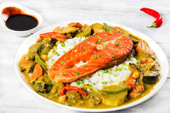 Fried steak of red fish with rice and homemade curry Stock Photography