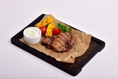 Fried steak with vegetables Stock Image