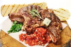 Fried steak on a wooden board Stock Image