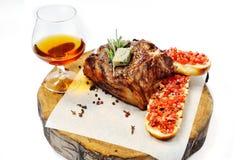 Fried steak on a wooden board Royalty Free Stock Photo