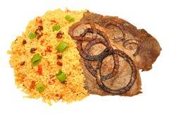 Fried Steaks And Couscous Meal Imagen de archivo libre de regalías