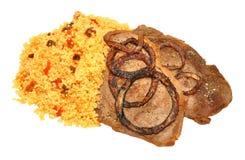 Fried Steaks And Couscous Meal Fotos de archivo libres de regalías