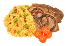 Fried Steaks And Couscous Meal Fotografía de archivo libre de regalías