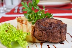 Fried steaks Stock Photos