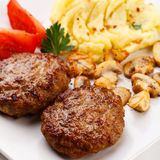 Fried Steaks With Potatoes And Fried Mushrooms