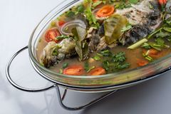 Fried Steamed Sea Perch in Lime Soup Sauce stock photography