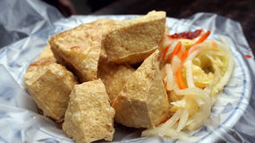 Fried stinky tofu with pickle vegetable and sauce on the side Stock Photo