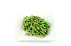 Fried string beans on the white plate Royalty Free Stock Images