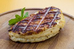 Fried Suluguni cheese on wooden Board stock images
