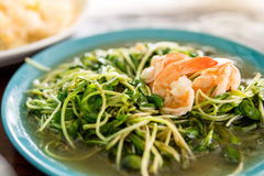 Fried sunflower sprouts with oyster sauce and prawn Stock Photos