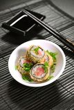 Fried sushi foursome. Hot sushi roll Tekke tempura, tuna, spicy sauce, cucumber on restaurant table Royalty Free Stock Photography