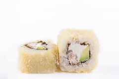 Fried sushi roll with eel, cream cheese, avocado. Japanese food. Hot roll with a crisp crusty on a white background. Stock Photos