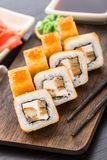 Fried sushi roll with eel and japanese omelette Royalty Free Stock Photos