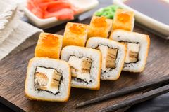 Fried sushi roll with eel and japanese omelette Royalty Free Stock Images