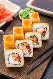 Fried sushi roll with salmon teriyaki Stock Photos