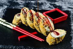 Fried sushi roll with sauce stock photos