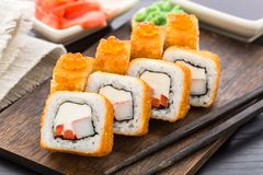 Fried sushi roll with shrimp and caviar Royalty Free Stock Image