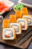 Fried sushi roll with shrimp and caviar Royalty Free Stock Photos