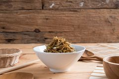 Fried sweet Anchovies in bowl stock photography