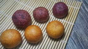 FRIED SWEET POTATO BALL, THAI SWEETMEAT. Sweet potato fried ball thai sweetmeat yummy market oil vegetable homemade traditional food purple snack dessert sphere royalty free stock photography