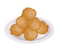 Fried Sweet Potato Balls met Sesam op Plaat Stock Fotografie