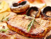 Fried tenderloin and grilled mushrooms Stock Photo