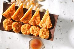 Fried thai shrimp cake. Thai shrimp cakes in traditional slice and lovely round shape, served with plum dipping sauce, good for snack Royalty Free Stock Images