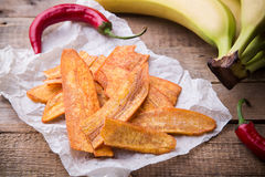Fried thinly sliced banana chips with chili pepper, Mexican fast food Royalty Free Stock Photo
