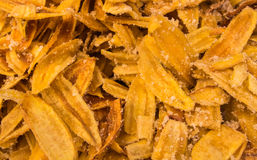 Fried thinly sliced banana chips, a tropical snack. Fried thinly sliced banana chips Stock Photos