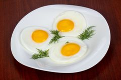 Fried three eggs stock photography