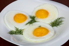 Fried three eggs stock photos