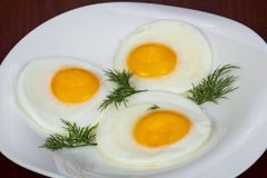 Fried three eggs stock images