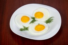 Fried three eggs. Served dill royalty free stock image