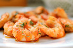 Fried tiger prawns with herbs on a white plate Royalty Free Stock Photography