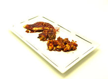 Fried tiger prawns and octopus in a Chinese style grilled barbecue in a spicy oil . Royalty Free Stock Image