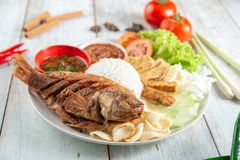 Fried tilapia fish and rice. Popular traditional Malay or Indonesian local food stock photography