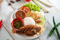 Fried tilapia fish and rice stock photo