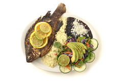Fried tilapia with rice, beans and salad Royalty Free Stock Images