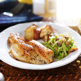 Fried tilapia with slaw and potatoes stock images