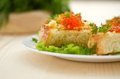 Fried toast with cheese and red caviar Stock Photography