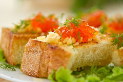 Fried toast with cheese and red caviar Stock Image