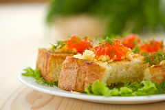 Fried toast with cheese and red caviar Stock Photos