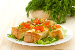 Fried toast with cheese and red caviar Royalty Free Stock Image