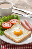 Fried toast with egg, sausage and a cup coffee. Stock Photo